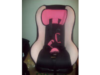 pale pink and black car seat