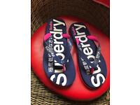 Women's Superdry flip flops size medium uk 5/6 worn once for 10 minutes