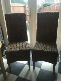 Two rattan weave dining chairs