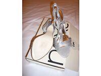 Pair of ladies silver sandals
