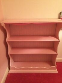 Pink painted book case.