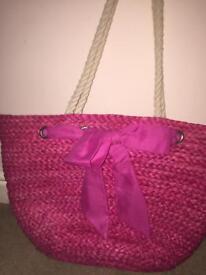 Woman's pink beach bag