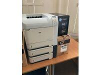 Two HP LaserJet printers