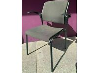 Elegant green upholstered stacking chairs with arms