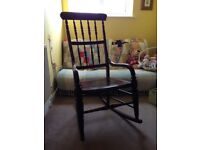 Wooden antique-style rocking chair, used as a nursing chair