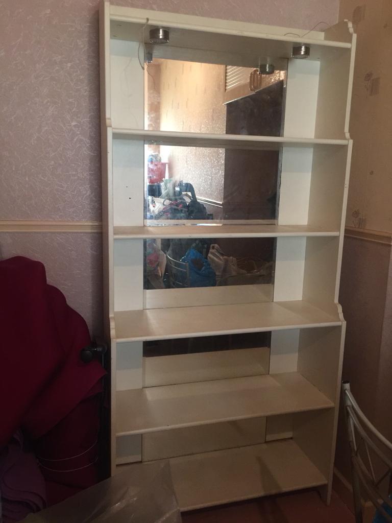 White wooden shelves / bookcase