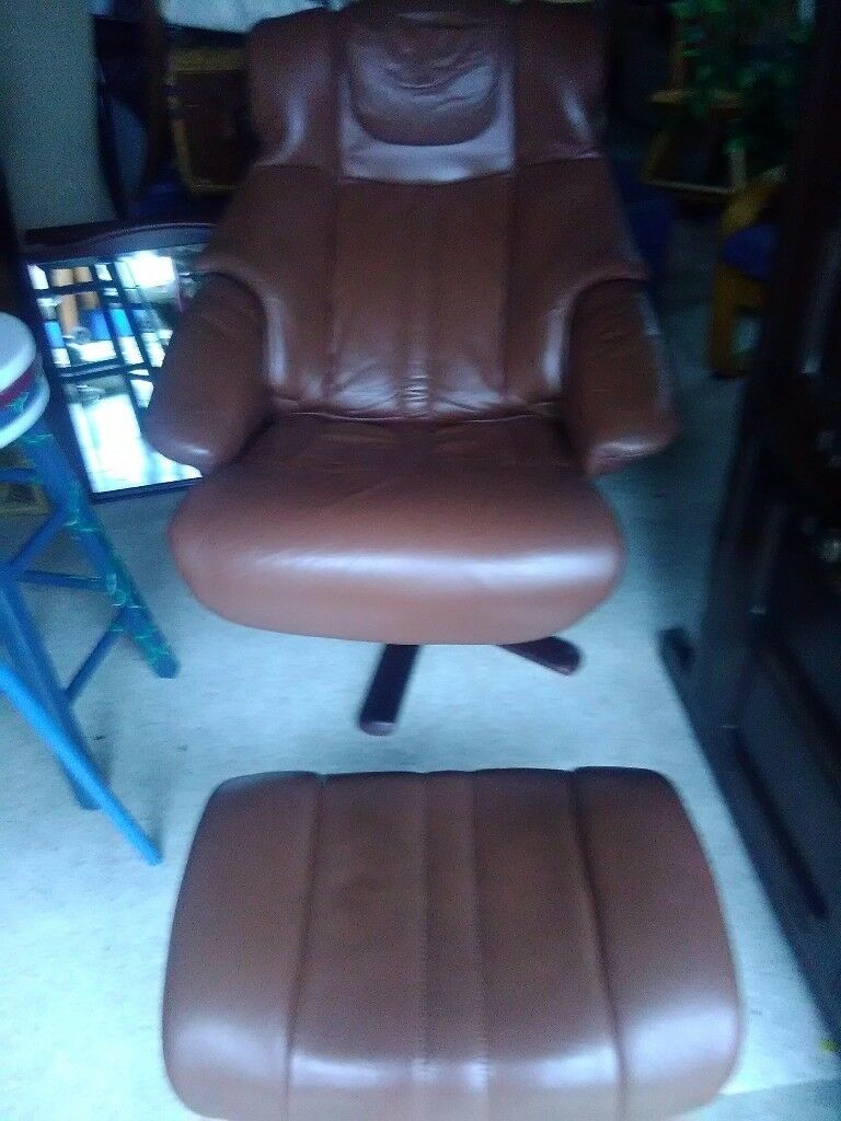 brown leather recliner /swivel .with footstool