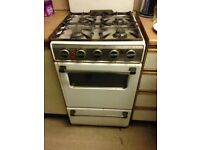 Cooker with oven, grill