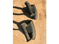 Vintage pair of cast iron clothes irons.