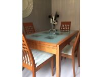 Table and chairs with drawered cabinet