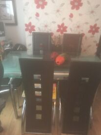 Glass table 6 faux leather chairs