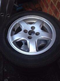 4 Alloys 4x100 with tyres 185/60 R14 (legal 4-5mm thread each)