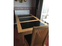 Solid wood dining table with black granite inlay and 4 chairs