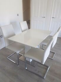 White gloss extending dining table with 4 Alcora chairs