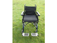 Manual Wheelchair in good condition, folds for storage, has cushion and removable foot rests