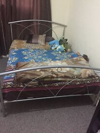 Double bed with almost new mattress