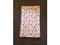 Brand new never used changing mat with pink floral detail