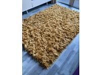 Large yellow rug
