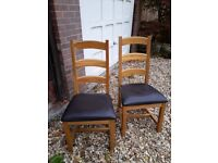 2 x Oak Chairs with Brown Faux Leather Seating