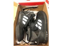 BLACK ADIDAS TRAINERS IN A SIZE 2 IN VERY GOOD CONDITION