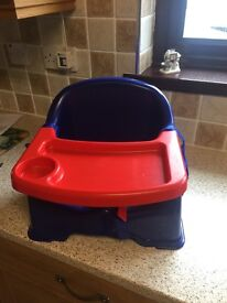 Child's booster seat with tray in perfect condition used on one occasion boxed as new