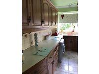Wooden door Kitchen with cream cupboards, worktops etc