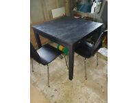 Black ash extending dinning table and 4 chairs