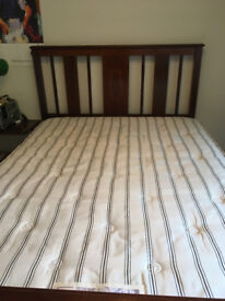 Antique wooden double bed with base and mattress