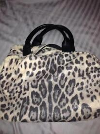 Silver/black animal print sheepskin bag