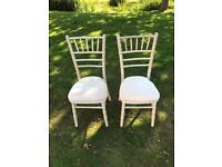 100 Limewash chiavari chairs with ivory seat pads