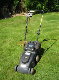 Rotary electric 1000w mower, small easy to use.
