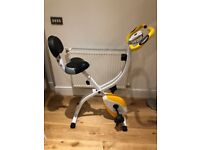 Good as new exercise bike inc speedometer. 8 settings. Stylish. Foldable for storage. With FREE mat!