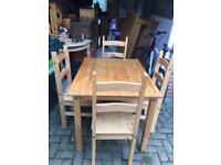 Pine table & 4 chairs in good solid condition