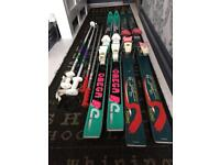 2 pairs of vintage skis and poles