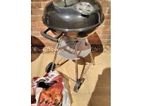 Kettle drum barbecue inc. some charcoal