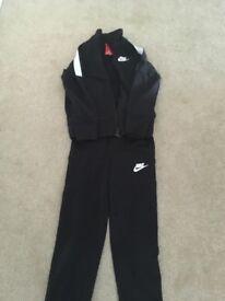 Nike tracksuit (6-8)