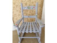 Child's wooden rocking chair painted in French chic paint and decorated with peter rabbit