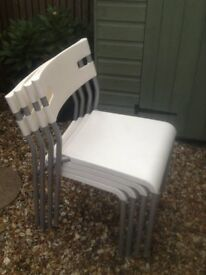 4 stackable chairs with metal frames, can be used indoors as well as outdoors, excellent condition