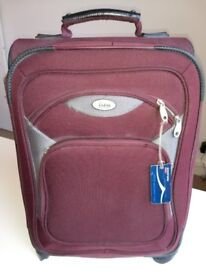 Superb red Bass suitcase / hand luggage with 4 wheels