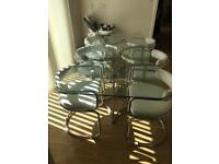 Contemporary Glass dining table and six chairs