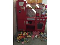 Red retro Kidcraft wooden play kitchen plus accessories and food