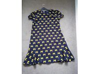 Black dress with Bow motifs on