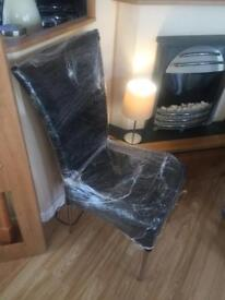 3 new black leather chairs