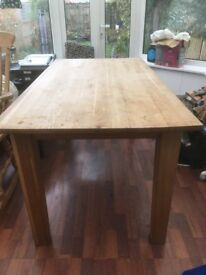 Solid wood dining table from Cargo