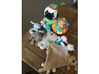 Job lot of various baby toys, soft rattles, stuffed Pug