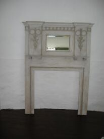 Fireplace in wood with mantlepiece and bevelled mirror above, 6ft 3ins tall with relief designs