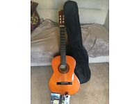 Genuine Stagg 3/4 guitar... been used once and comes with all extras!