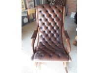 A pair of Chesterfield Rocking Chairs