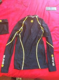Skins compression top and shorts