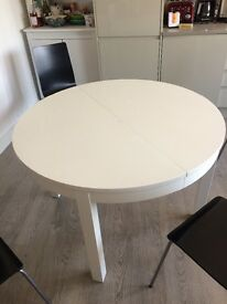 Ikea kitchen table - round with one extendable leaf. White.